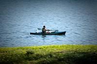 Man paddling a kayak.