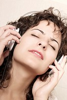 A young woman listening music with Headphones.