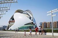 Visitors by signpost and the El Palau de les Arts Reina Sofía building in the science park at Valencia.