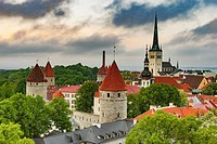 View over Tallinn to the city wall and the St. Olavs Church (Oleviste kirik). The church was built in Gothic style and is located in the northern part...
