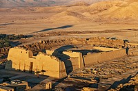Aerial view of the Mortuary Temple of Ramesses III at Madinat Habu at sunrise, Luxor, New Valley Governorate, Egypt.