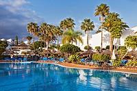 Holiday apartment complex and pool in Golf del Sur, Santa Cruz de Tenerife, Tenerife, Canarias, Spain.