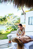Massage therapist treating a female customer at luxury wellness retreat in Mismaloya, Puerto Vallarta South Shore, Jalisco, Mexico.