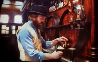 Barman Pouring Stout in Ryan's Traditional Pub with Victorian features. Parkate Street, Dublin City, Ireland.