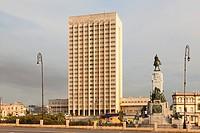 """Hermanos Ameijeiras Hospital (Hospital Clínico Quirúrgico """"""""Hermanos Ameijeiras"""""""") with the Antonio Maceo Statue in Central Havana, Cuba."""