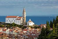 Dawn view over St George Parish Church and old town Piran, Primorska, Slovenia.
