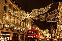 Street Christmas decoration in Regent Street December 2016 with red busses, lighting angels.