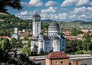 Romanian Orthodox Holy Trinity Church - view from hill of Historic Centre of Sighisoara city, Transylvania region in Romania.