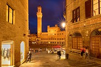 Twilight over Torre del Mangia and Piazza del Campo, Siena, Tuscany, Italy.