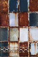 Old weathered rusty metal door.