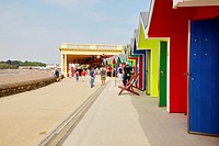 Whitmore Bay, Pavillion and beach huts, at Barry Island, South Wales, UK