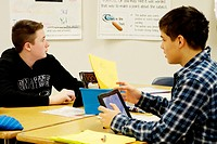 7th Grade Boys Using iPads for Lesson, Wellsville, New York, USA.