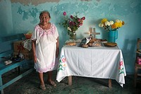 A woman poses by an altar displayed in the Mayan village of Pomuch, Hecelchakan, Campeche, Yucatán península, October 30, 2016, as part of Day of the ...
