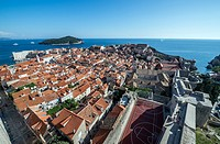 Aerial view from defensive Walls of Dubrovnik on the Old Town of Dubrovnik city, Croatia. Lokrum on background.