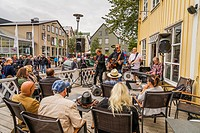 People at a cafe, Menningarnott, Annual Cultural Festival to mark the end of the summer, Reykjavik, Iceland.