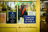 Inside an antiques store in Bath, Somerset, various signs adorn the windows of the office area. The great variety show humour and and information at t...