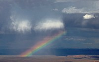A rainbow appears during a thunderstorm at Marble Canyon at Grand Canyon National Park, Arizona.