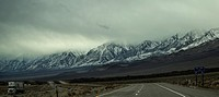 The snow-covered Sierra Nevada Mountains are the predominate feature at Owens Valley, California.
