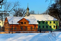 Winter scene, Open-air Museum of regional Wooden Architecture - integral part of Central Museum of Textiles, located on main artery of Lodz - Piotrkow...