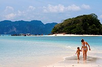 Visitors on the exotic white sand beach Ko Tup island off Ao Nang Thailand. Ko Poda is an island off the west coast of Thailand, in Krabi Province, ab...