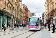 Electric trams on Corporation Street in Birmingham City Centre.