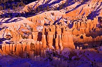 Evening light on snow-dusted rock formations below Bryce Point, Bryce Canyon National Park, Utah USA.