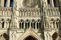Gothic statues and the facade of the Gothic Cathedral of Notre-Dame, Amiens, France.
