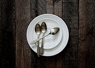 Plate and spoons in bottom of wood.