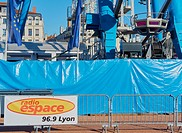 Ferris wheel and local radio advert, La Place Bellecour, Lyon, Auvergne-Rhone-Alpes, France, Europe. . A UNESCO world heritage site at the heart of Pr...