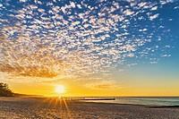 Sunset at the beach of the Baltic Sea in Kolobrzeg, Western Pomerania, Poland, Europe.