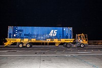 Cargo truck transporting a blue container of goods in Santa Cruz de Tenerife dock at night