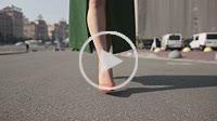 Sexy woman's legs in high heels walking in street