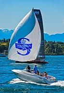 Sailing boat flying a spinnaker sail on Lake Geneva, boat HUN 92 Implant Centre Raffica, Bol d'Or Mirabaud regatta, Geneva, Switzerland.