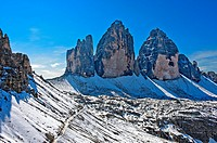 Three Peaks mountains, Tre Cime di Lavaredo, and Lavaredo Col, Forcella di Lavaredo, hiking trail of the Three Peaks Circular Walk in the snow, Sesto ...