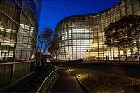 The National Art Center Tokyo exterior at dusk in Roppongi, Tokyo, Japan (architect Kisho Kurokawa).
