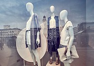 Mannequins and reflections at a window shop at Sol Square. Madrid. Spain.