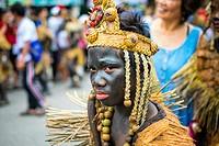 Kalibo, Aklan, Western Visayas, Philippines. A participant in the Ati-atihan festival wearing hand-made costume made from natural materials. Ati-Atiha...