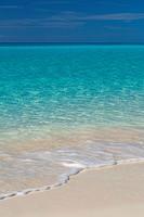 Blue and green water off Halfmoon Cay Beach, Bahama Islands.
