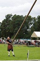 The caber toss, a traditional Scottish athletic event. Highland Games. Aboyne. Aberdeenshire. Scotland. Europe.