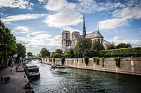 Notre Dame cathedral with puffy clouds, Paris, France.
