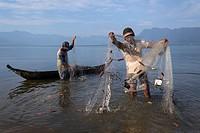 Fishermen at work in the Lake Maninjau, Sumatra, Indonesia.