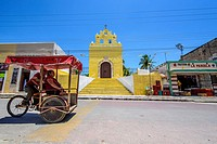 Bici-Taxi in front of the Chapel in Acanceh, Yucatan state, Mexico.