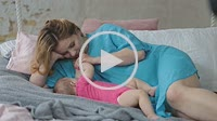 Affectionate mother breastfeeding her baby girl