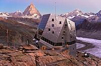 Dawn at the Monte Rosa Hut, Monte Rosa Hütte, above the glacier Gornergletscher, peak Matterhorn behind, Zermatt, Valais, Switzerland.