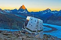 Dawn at the Monte Rosa Hut, Monte Rosa Hütte, above the glacier Gornergletscher, first sun rays at the top of the Matterhorn peak, Zermatt, Valais, Sw...