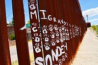 Commentary on the wall that indicates the international border with Nogales, Arizona, USA, as seen from Nogales, Sonora, Mexico.