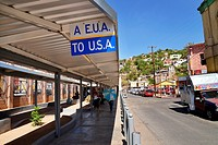 Pedestrians enter the customs inspection station to cross the international border into Nogales, Arizona, USA, from Nogales, Sonora, Mexico. The foot ...