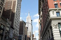 the burton building looking up 5th avenue with view of the empire state building New York City USA.