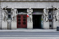 Atlantes - five full size statues. entrance to tenement house Narutowicza street number 45 built in 1913, Lodz, Poland, Europe