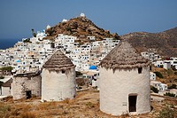 View to the blue domed Cathedral church and the chapels in the old town Hora with the old windmills in the foreground, Ios, Cyclades Islands, Greek Is...